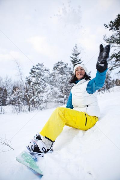 Kış kadın snowboard kadın oturma Stok fotoğraf © ElinaManninen