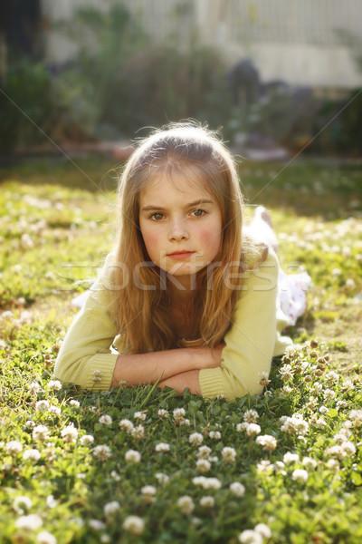 Csinos fiatal lány fű virágok portré hosszú hajú Stock fotó © ElinaManninen
