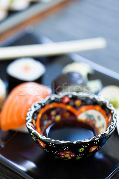 Bowl soy sauce on sushi plate Stock photo © ElinaManninen