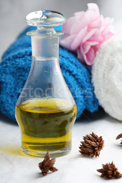 Massage oil and towels. Stock photo © ElinaManninen