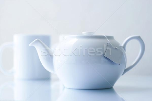 Tea pot and mugs. Stock photo © ElinaManninen