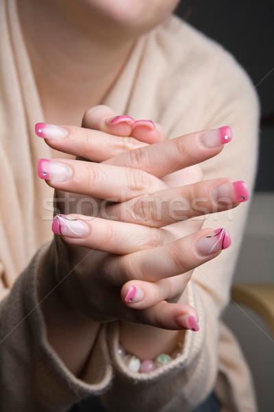 Gyönyörű körmök női kezek rózsaszín kéz Stock fotó © ElinaManninen