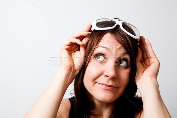 álmodozás fiatal trendi nő felfelé néz stúdiófelvétel Stock fotó © ElinaManninen