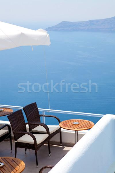 патио Санторини Греция стульев синий острове Сток-фото © ElinaManninen