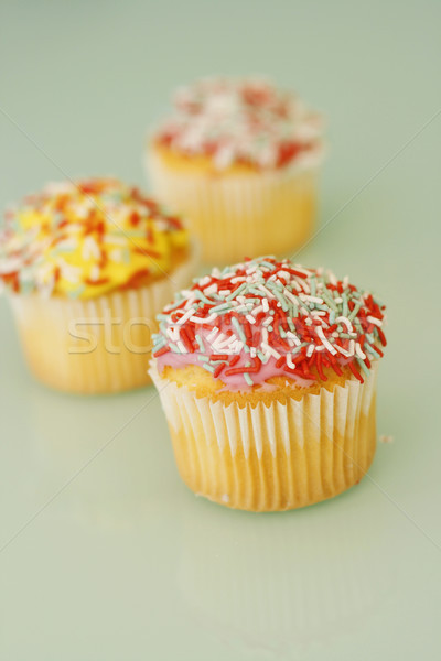 Brightly colored cupcakes. Stock photo © ElinaManninen