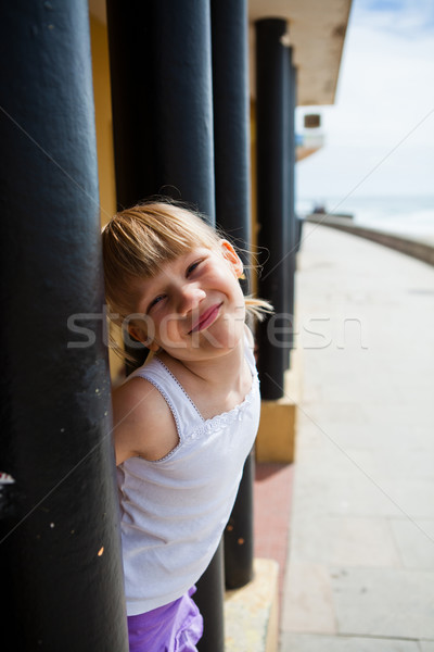 Young girl on beachside walkway Stock photo © ElinaManninen