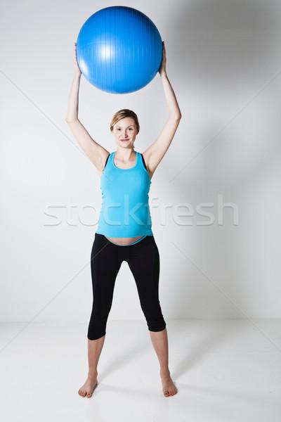 Stock fotó: Terhes · nő · nyújtás · fitnessz · labda · tart · kék