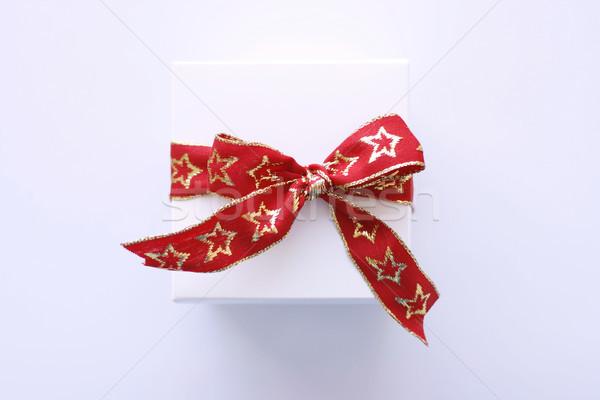 Karácsony ajándék fehér csomagolás vörös szalag közelkép Stock fotó © ElinaManninen