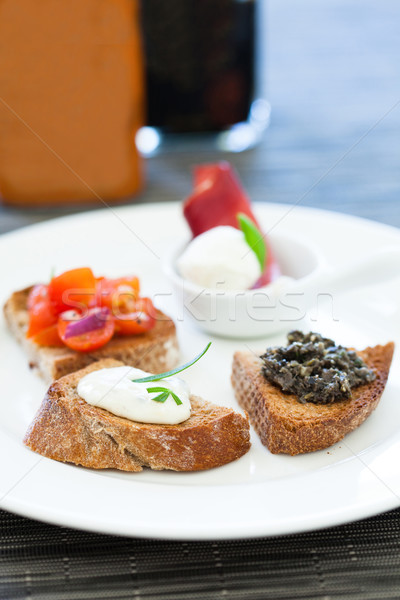 Bruschetta appetizers on plate Stock photo © ElinaManninen