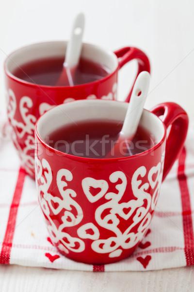 Karácsony bor kettő kicsi piros csészék Stock fotó © ElinaManninen