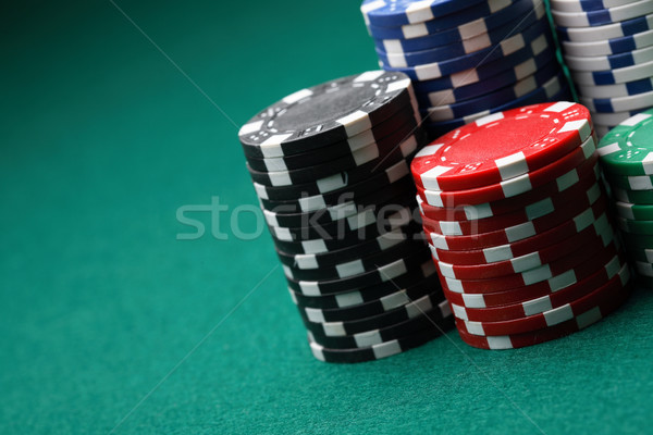 Stacks of poker chips on a green surface. Stock photo © ElinaManninen