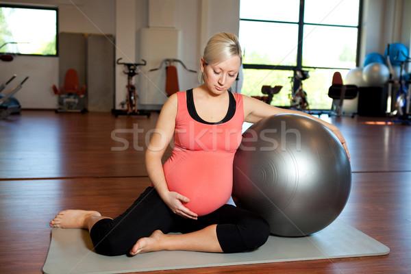 Pregnant woman doing relaxation exercise Stock photo © ElinaManninen