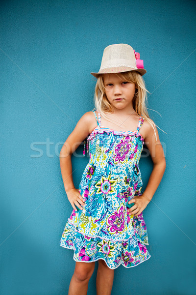 Komoly néz fiatal lány portré aranyos visel Stock fotó © ElinaManninen