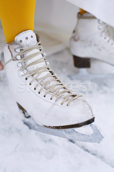 Close-up of an ice skate on a female foot. Stock photo © ElinaManninen
