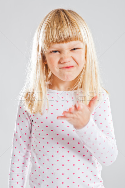 Young girl with funny grin Stock photo © ElinaManninen