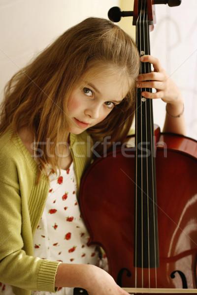 Közelkép portré csinos fiatal lány cselló hosszú hajú Stock fotó © ElinaManninen