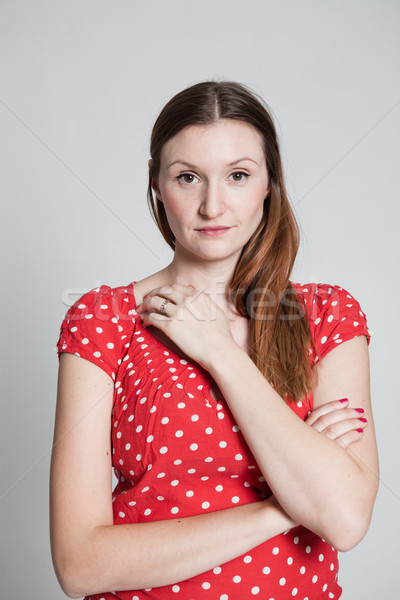 Figyelmes néz vonzó nő stúdió portré nyugodt Stock fotó © ElinaManninen