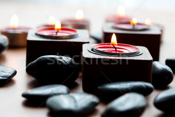 Gyertyák kövek közelkép fekete piros szépség Stock fotó © ElinaManninen
