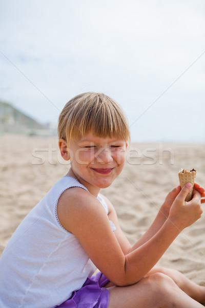 Happy girl with ice cream on beach Stock photo © ElinaManninen