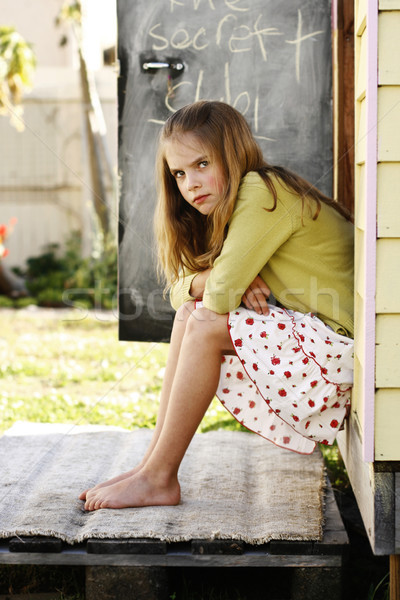 Portrait joli grincheux regarder jeune fille séance Photo stock © ElinaManninen