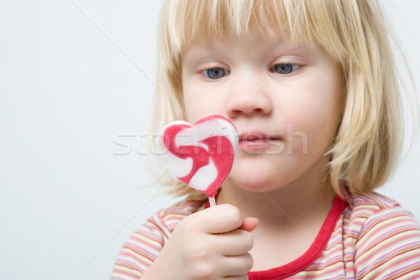 Sevimli küçük kız lolipop kalp şekli kız sevmek Stok fotoğraf © ElinaManninen