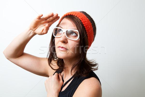 Young trendy woman saluting Stock photo © ElinaManninen