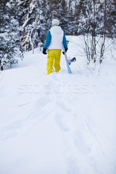 Hiver femme planche à neige Homme marche Photo stock © ElinaManninen