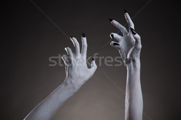 Spooky Halloween white hands with black nails stretching up   Stock photo © Elisanth