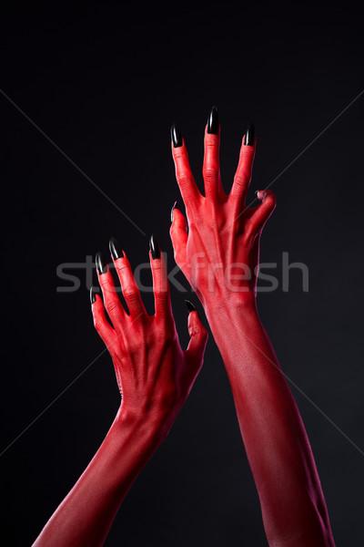 Rood duivel handen zwarte nagels uit Stockfoto © Elisanth