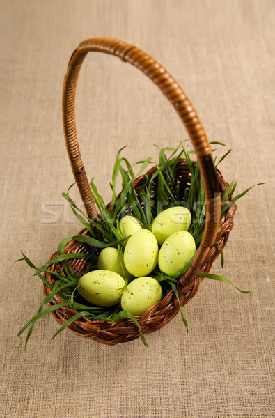 Basket with Easter eggs and grass  Stock photo © Elisanth
