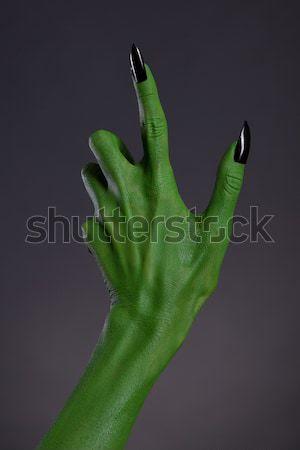 Groene heks hand zwarte nagels echt Stockfoto © Elisanth