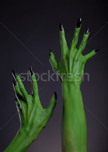 Green monster hands with black nails stretching up, real body-ar Stock photo © Elisanth