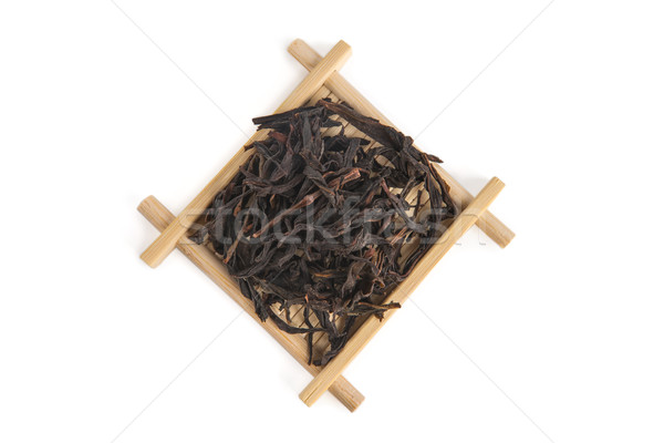 Honey Orchid Dan Cong 'Phoenix Bird' Oolong on bamboo servin Stock photo © Elisanth