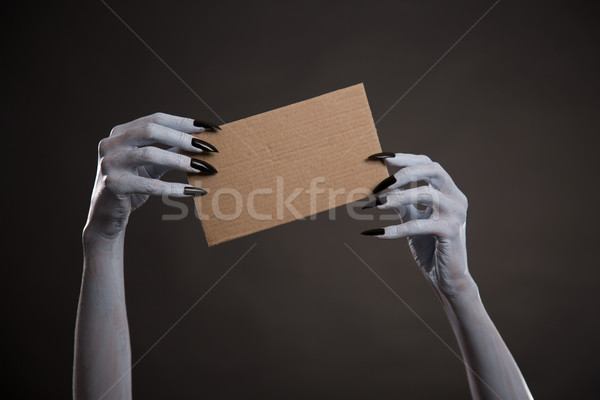 White witch hands with black nails holding blank cardboard  Stock photo © Elisanth