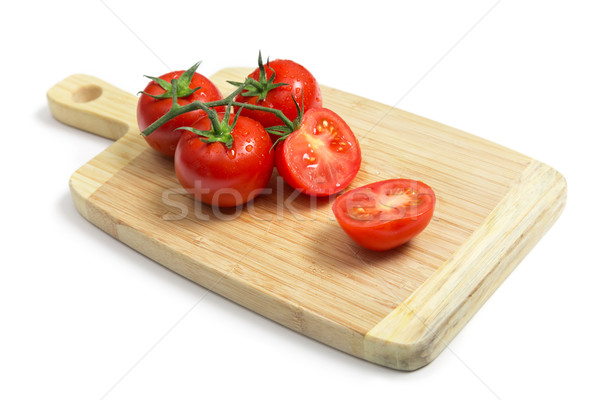 Fresh tomatoes on wooden chopping board   Stock photo © Elisanth