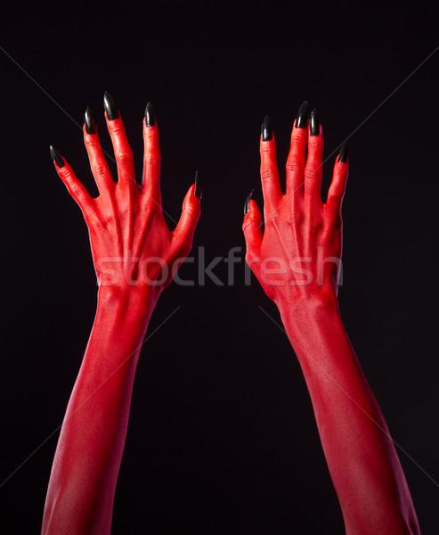 Czerwony diabeł ręce czarny paznokcie halloween Zdjęcia stock © Elisanth