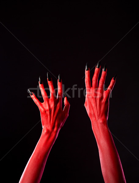Red spooky devil hands with black nails, real body-art  Stock photo © Elisanth