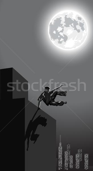 ночь городского прыжки мальчика город небе Сток-фото © Elisanth