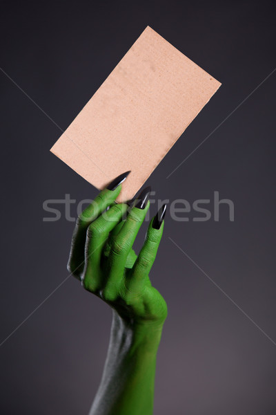 Green monster hand holding blank piece of cardboard  Stock photo © Elisanth