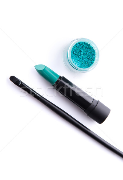 Top view of makeup brush, lipstick and eye shadow in bold teal g Stock photo © Elisanth