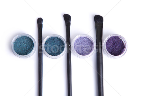 Stock photo: Top view of mineral eye shadows in pastel colors and brushes