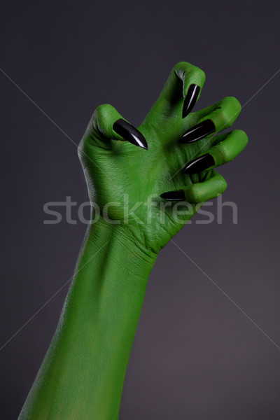 Green witch hand with sharp black nails, real body-art  Stock photo © Elisanth