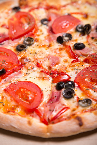 Close-up shot of delicious Italian pizza with ham, tomatoes and  Stock photo © Elisanth