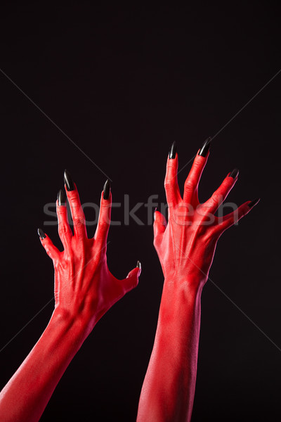 Red devil hands with sharp black nails, real body-art  Stock photo © Elisanth