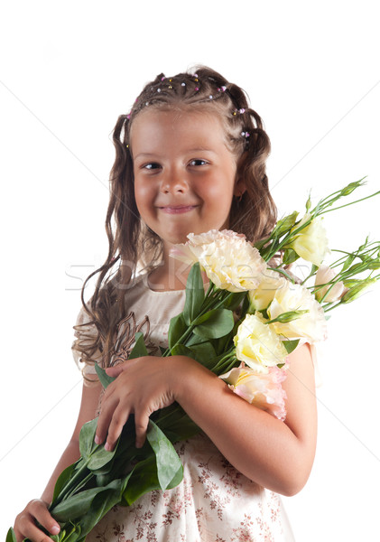 Smiling little girl with pigtail hairstyle holding flowers  Stock photo © Elisanth