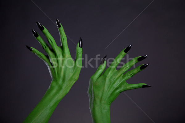 Green monster hands with black nails, real body-art  Stock photo © Elisanth