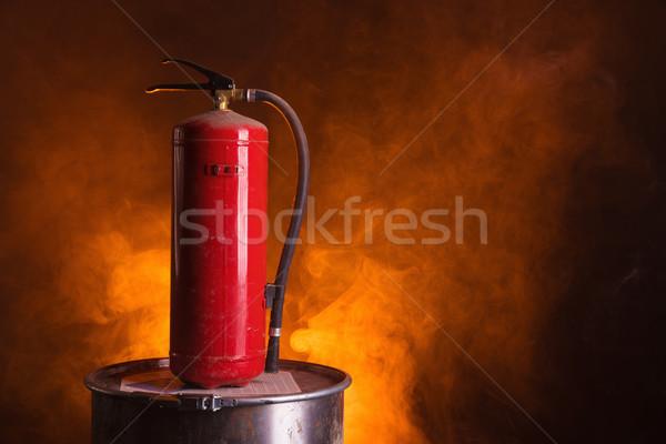 Tűzoltó készülék narancs füstös fényes tűz háttér Stock fotó © Elisanth