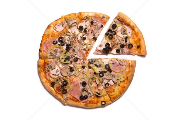 Tasty Italian pizza with ham, one slice removed  Stock photo © Elisanth