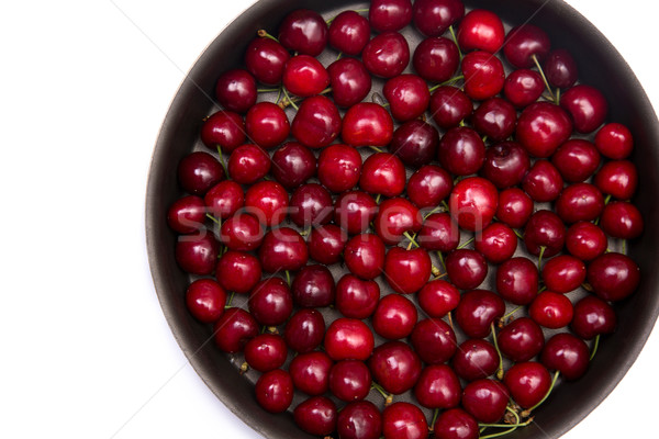 Red cherries in round baking tin Stock photo © Elisanth