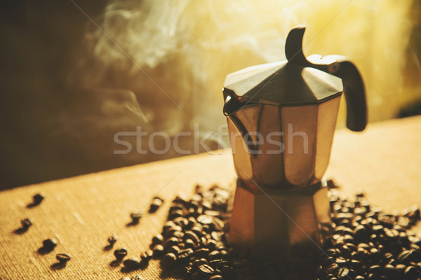 Artistic shot of old coffee maker and coffee beans  Stock photo © Elisanth